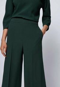 BOSS - Trousers - open green - 3