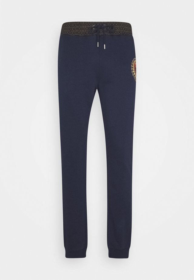 PANT - Tracksuit bottoms - blue