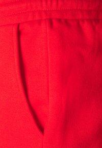 YOURTURN - UNISEX - Tracksuit bottoms - red - 2