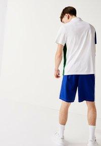 Lacoste Sport - GH2105 - Sports shorts - blanc  bleu - 1