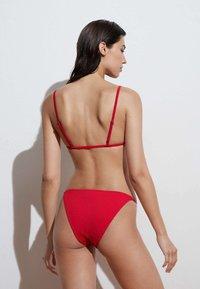 OYSHO - STRAPPY CLASSIC  - Bikini bottoms - red - 1