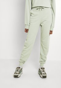 NU-IN - FIT - Tracksuit bottoms - green - 0