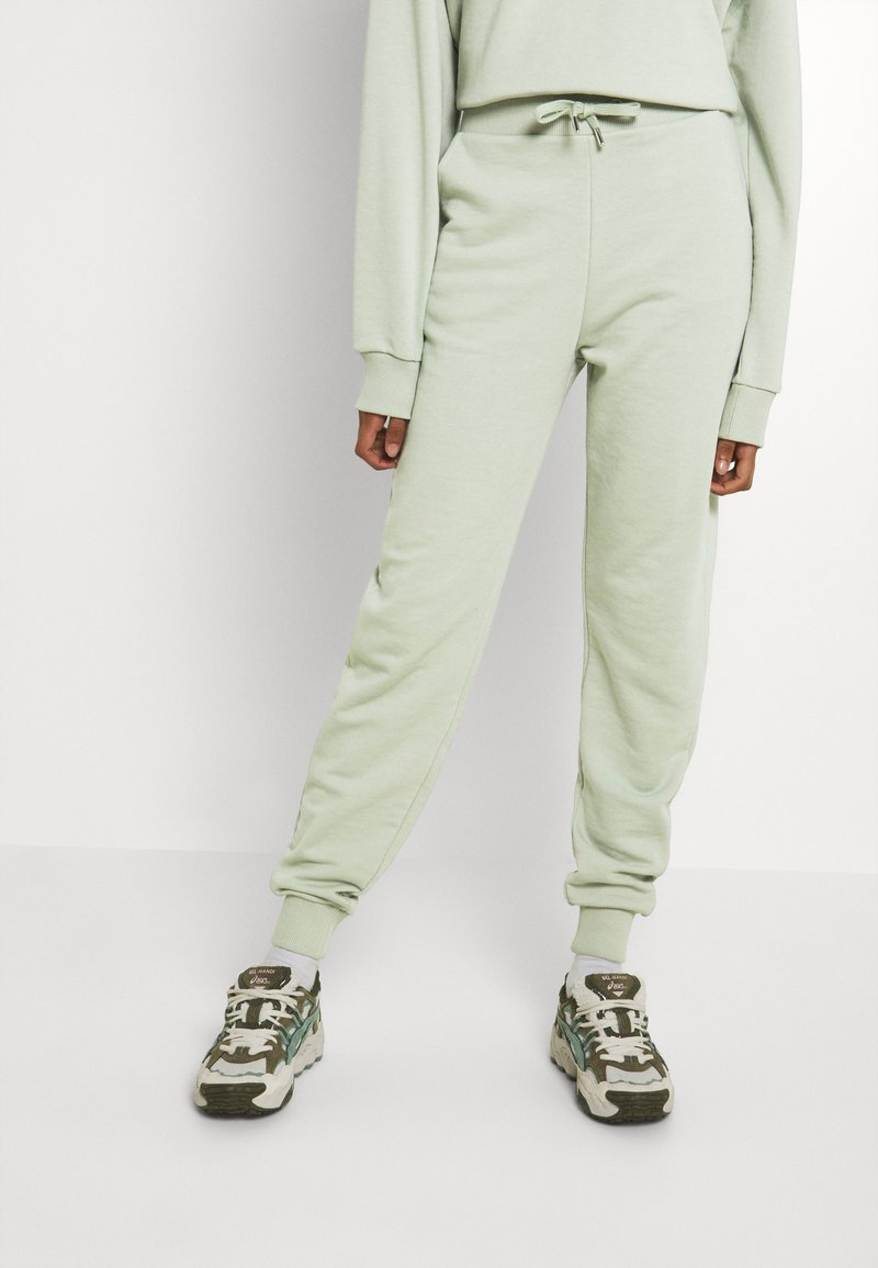 NU-IN - FIT - Tracksuit bottoms - green