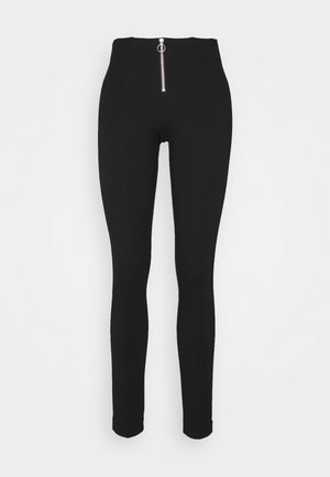 ONLTIA ZIP - Trousers - black