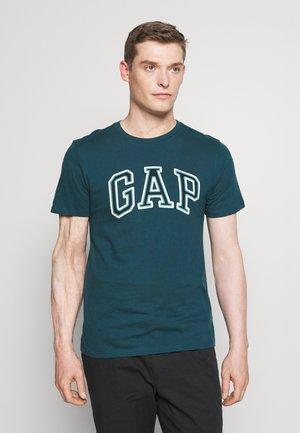 BAS ARCH - T-shirt print - tumbling teal