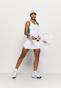 Lacoste Sport - TENNIS TANK - Sports shirt - white/cosmic greenfinch/black - 1