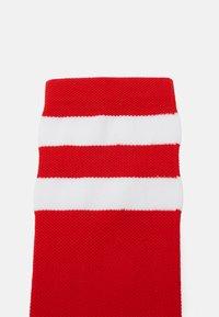 Giro - COMP RACER HIGHRISE UNISEX - Sports socks - bright red - 1