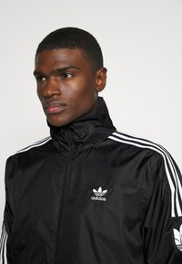 adidas Originals - UNISEX - Training jacket - black/white - 3