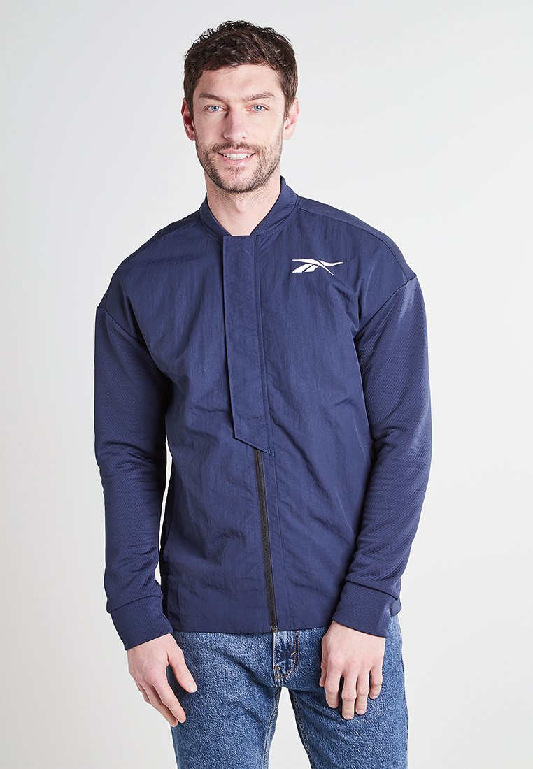Reebok - Training jacket - dark blue