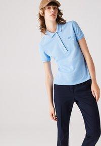 Lacoste - Polo shirt - bleu - 0