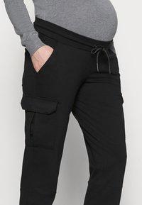 MAMALICIOUS - MLMARIE JERSEY PANTS - Pantalones deportivos - black - 3