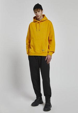Luvtröja - light yellow