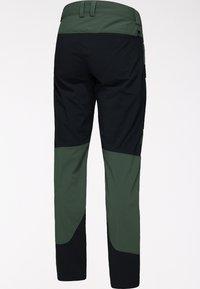 Haglöfs - Outdoor trousers - fjell green/true black - 6