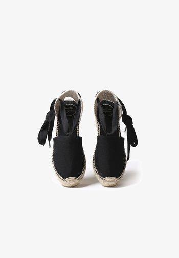VALENCIA - Wedge sandals - black