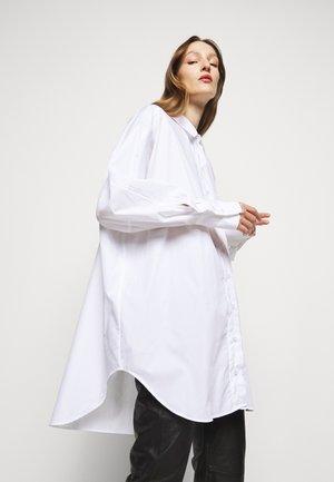 ELLIONOR - Button-down blouse - white