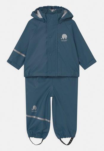 BASIC RAINWEAR SOLID SET UNISEX - Rain trousers - iceblue