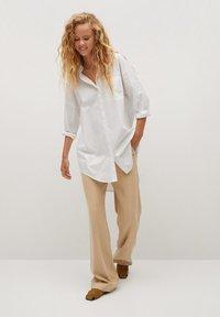 Mango - LONG-A - Button-down blouse - weiß - 1