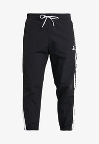 Reebok - MEET YOU THERE TRAINING 7/8 JOGGER PANTS - Tracksuit bottoms - black - 4