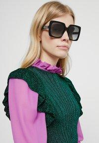 Gucci - Sonnenbrille - black/grey - 1