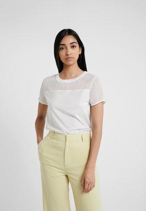 DIKERI - Print T-shirt - natural