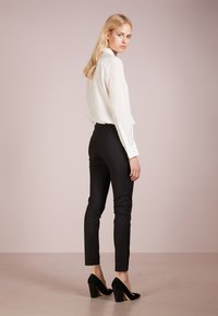 Filippa K - MILA PANTS - Trousers - black - 2
