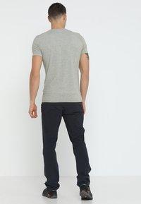 Mammut - RUNBOLD PANTS  - Pantalon classique - black - 2