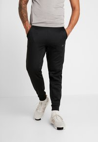 Nike Performance - PANT TAPER - Pantalon de survêtement - black/mtlc hematite - 0