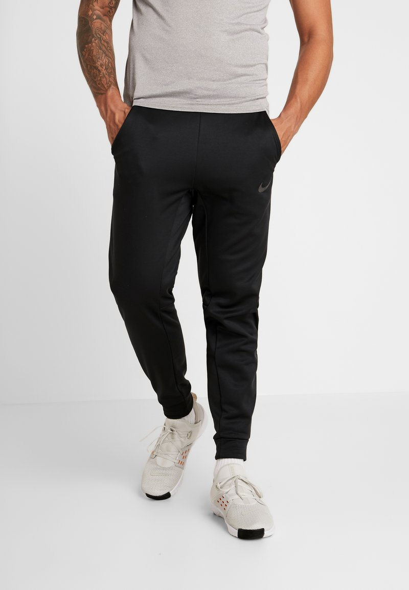Nike Performance - THRMA TAPER - Trainingsbroek - black/mtlc hematite