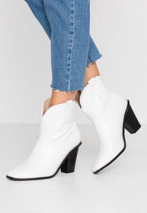 NIKITA - Kotníková obuv na vysokém podpatku - white