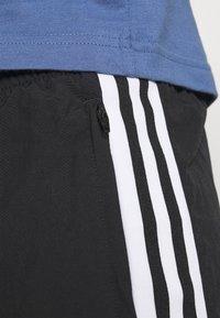 adidas Originals - LOCK UP UNISEX - Träningsbyxor - black - 6