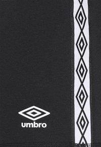 Umbro - TAPED SHORT LOOPBACK - Sports shorts - black - 5