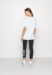 Nike Sportswear - FEMME - Leggings - Trousers - black - 2