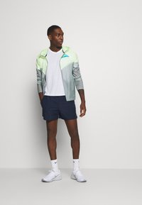 Nike Performance - MILER  - Basic T-shirt - white/silver - 1