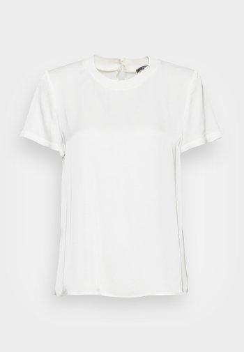 Pusero - off white