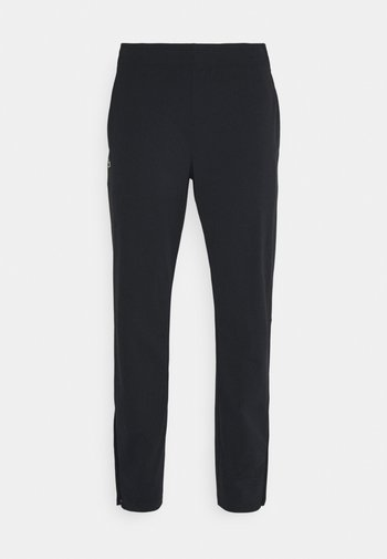 NAMING TRACK PANT - Träningsbyxor - black/white