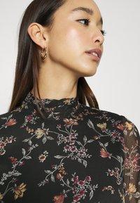 Vero Moda - VMTILI HIGH NECK SHORT DRESS - Day dress - black/tiny - 3