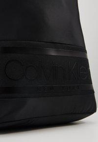 Calvin Klein - STRIPED LOGO ROUND BACKPACK - Rucksack - black - 5