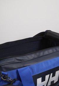 Helly Hansen - SCOUT DUFFEL M - Sports bag - navy - 5