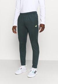 4F - Men's training pants - Tracksuit bottoms - green - 0