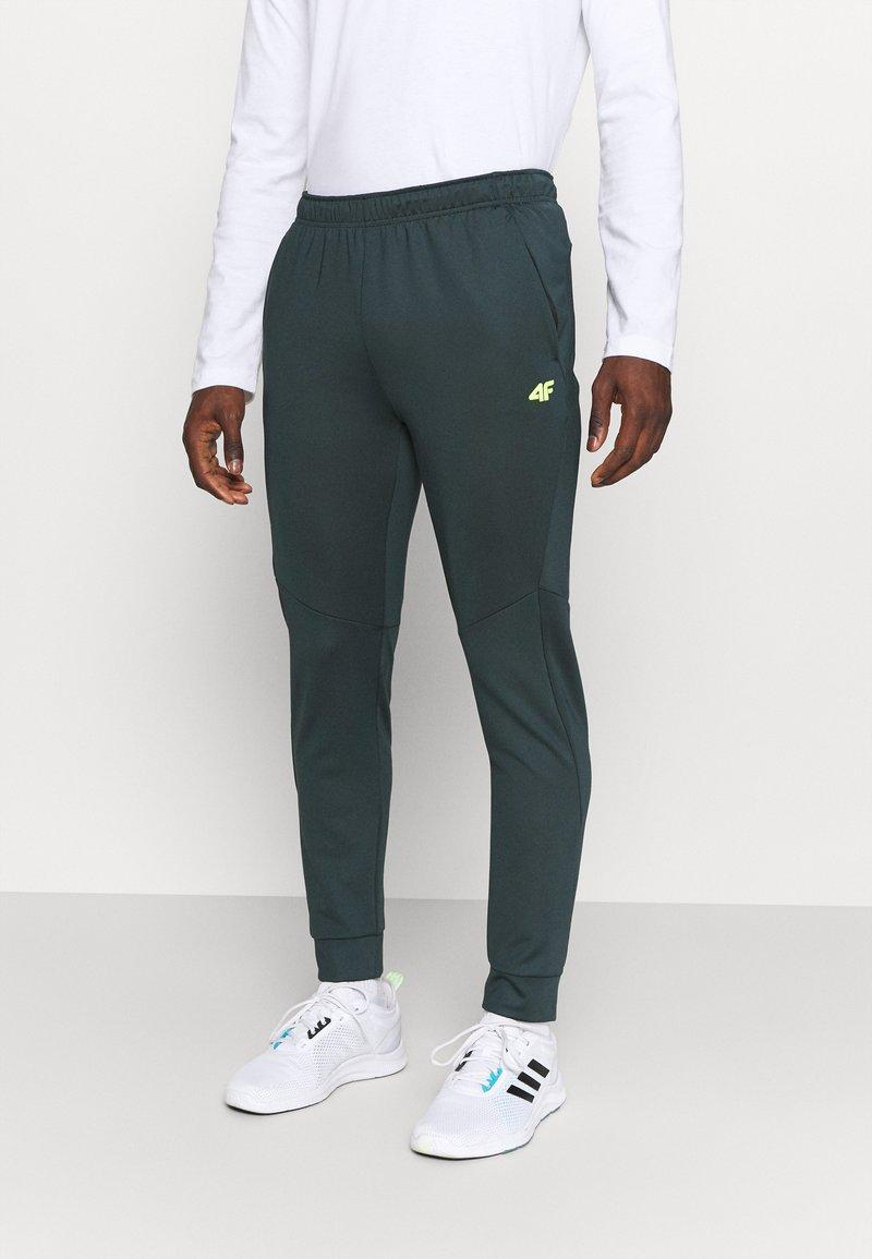 4F - Men's training pants - Tracksuit bottoms - green
