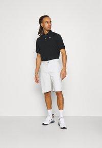 Nike Golf - DRY FIT ESSENTIAL SOLID - Sports shirt - black - 1