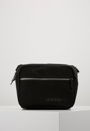 MODERN AIRLINER - Sac banane - black