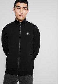 Guess - FOX TRACK  - Zip-up hoodie - jet black - 0