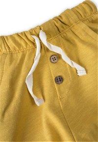 Cigit - Tracksuit bottoms - mustard yellow - 2