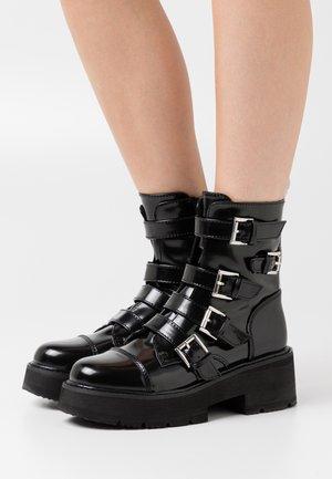 MOLLIE - Platform ankle boots - black