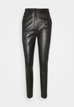 DRAINPIPE TROUSER - Pantalon en cuir - black