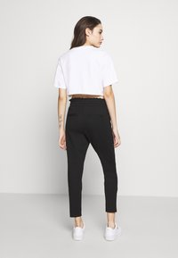 ONLY Petite - ONLPOPTRASH EASY FRILL PANT - Trousers - black - 2