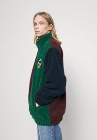 adidas Originals - COLLEGIATE CREST TEDDY TRACK JACKET - Light jacket - green/maroon/conavy - 3