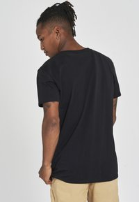 recolution - RECO BADGE - Basic T-shirt - black - 2