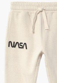 Cotton On - NASA SLOUCH - Tracksuit bottoms - dark vanilla - 2